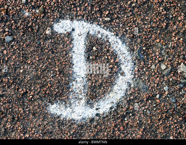 Letter D painted on road surface - France. - Stock Image