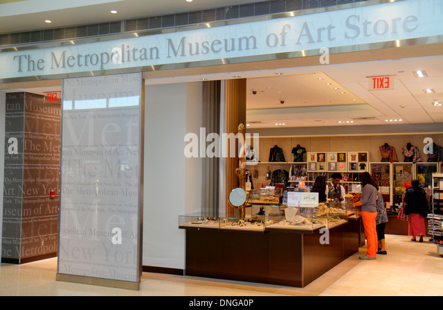 New Jersey Newark Newark Liberty International Airport EWR terminal concourse gate area shopping Metropolitan Museum - Stock Image