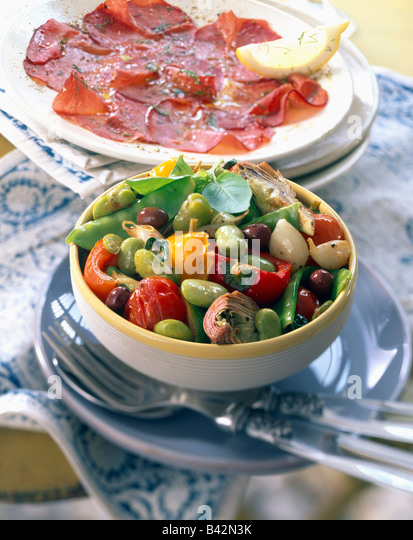 Plate of Bresaola mixed vegetables fried Italian-style - Stock Image
