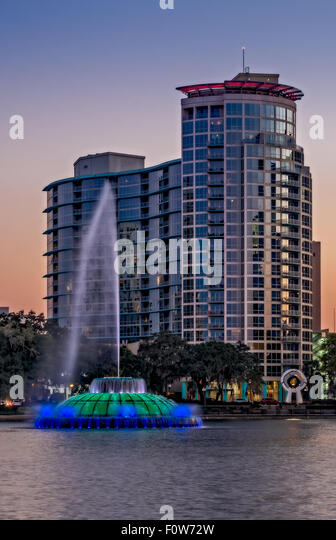 Lake Eola Water Fountain and the Orlando Florida skyline. - Stock Image