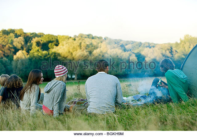 A group of young friends having a barbecue - Stock Image