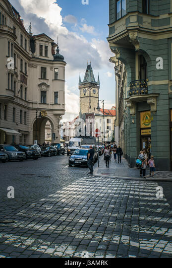People throng the streets in Prague with a view towards Old Town Square and the Old Town Hall and Astronomical Clock. - Stock Image