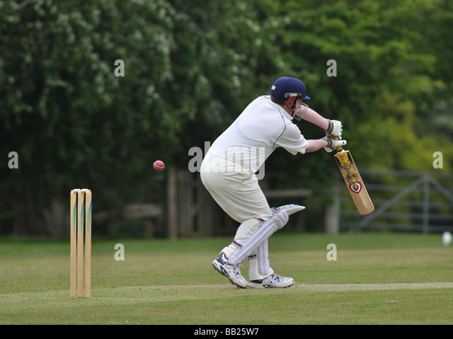 Village cricket at Lapworth, Warwickshire, England, UK - Stock Image