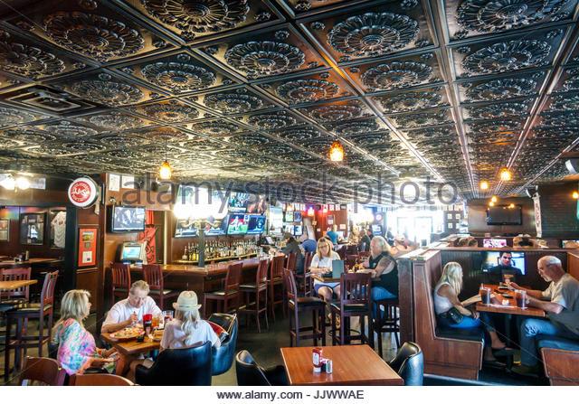 South Carolina SC Myrtle Beach Dagwood's Deli & Sports Bar restaurant casual dining tin metal tiles ceiling - Stock Image