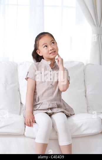 Little Girl Thinking - Stock Image