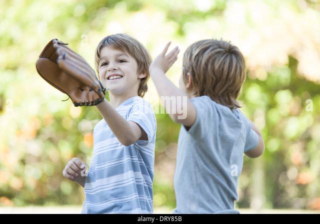 Boy wearing basebal glove - Stock Image