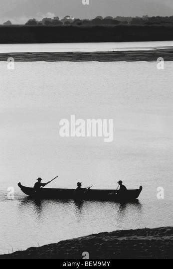 Myanmar (Burma), landscape with fishermen and canoe - Stock Image