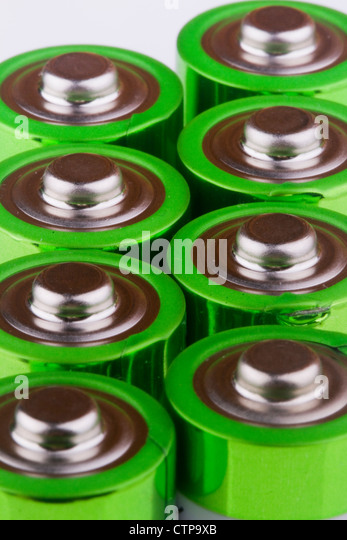 close up the top of AA battery,color on green - Stock-Bilder