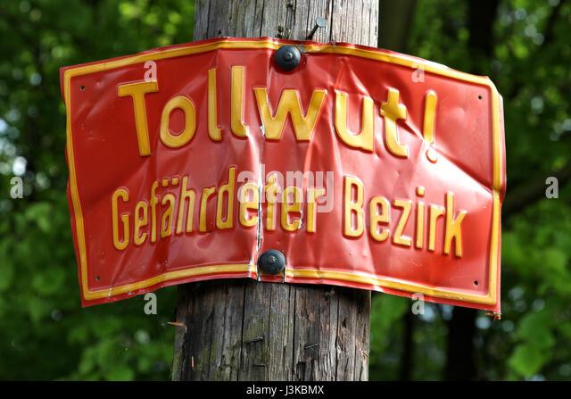 rabies warning sign in German language - Stock Image