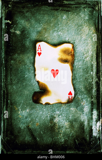 Burned ace of hearts - Stock-Bilder