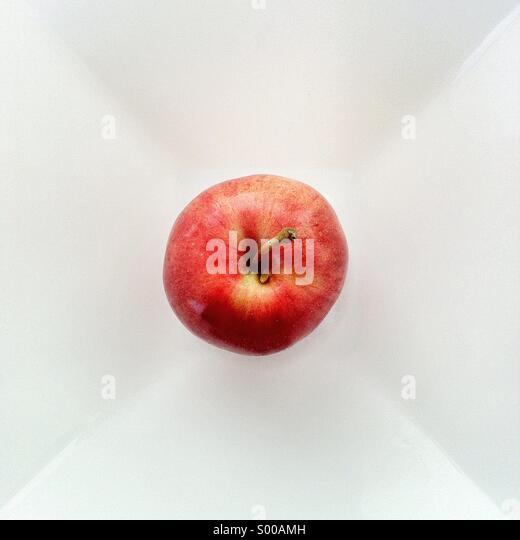 Still life of apple on plate - Stock Image