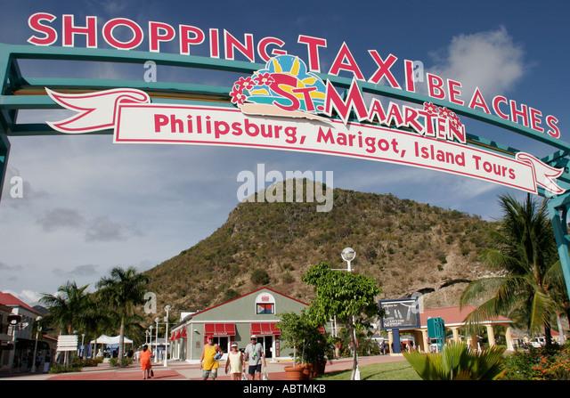 Sint Maarten Philipsburg Dutch cruise port entrance sign duty free shops Point Blanche Mountain - Stock Image