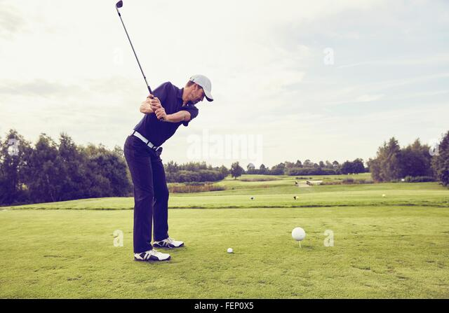Golfer playing golf on course, Korschenbroich, Dusseldorf, Germany - Stock Image