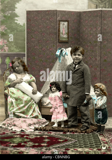 Little Children Mother & Father with Doll Family - Stock-Bilder