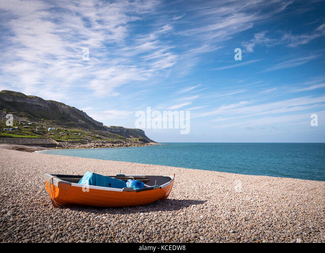 Rowing boat on the beach Chesil Beach Portland Dorset England - Stock Image