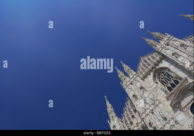 Duomo Cathedral against clear blue sky, Milan, Italy - Stock Image
