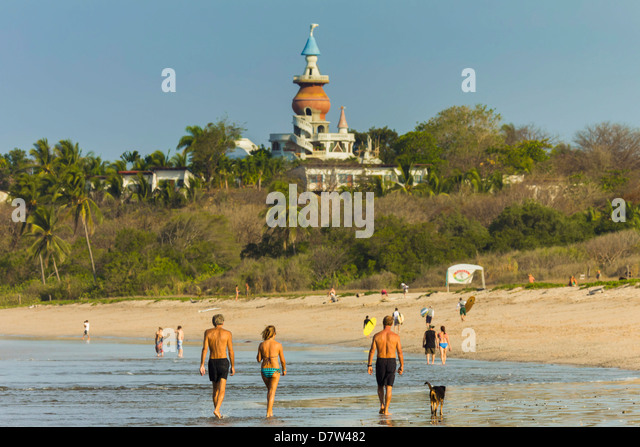 Walkers & the Nosara Beach Hotel at popular Playa Guiones beach, Nosara, Nicoya Peninsula, Guanacaste Province, - Stock Image