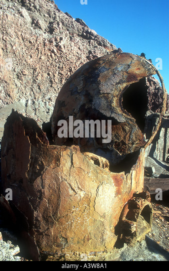 A badly corroded boiler from the long abandoned sulphur factory on White Island Bay of Plenty North Island New Zealand - Stock Image