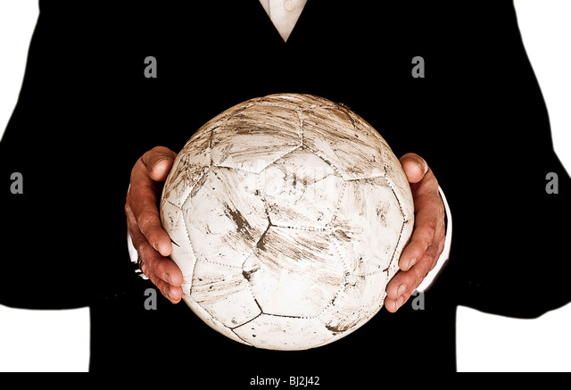 Football manager or coach holding football - Stock Image