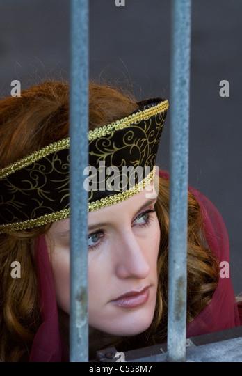 Victorian woman behind bars - Stock Image