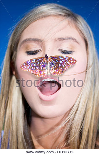 Nature Connection Concept Showing A Head Shot Of An Attractive Blond Woman With A Butterfly On Her Nose - Stock-Bilder