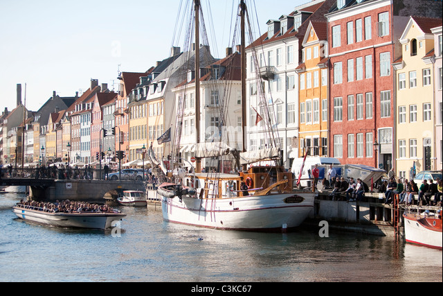 Waterfront with boats and cafes - Stock Image