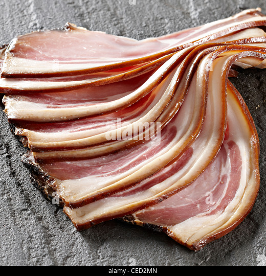 smoked bacon rashers fanning out - Stock Image