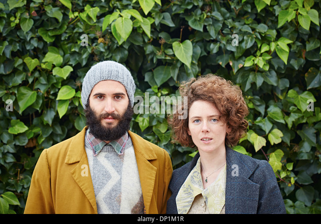 Smiling hipster student couple in vintage clothes - Stock-Bilder