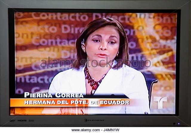 Miami Beach Florida flat panel TV television screen shot media Spanish language Telemundo news newscast broadcast - Stock Image