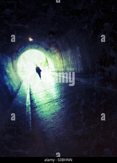 Silhouette of woman in tunnel - Stock Image