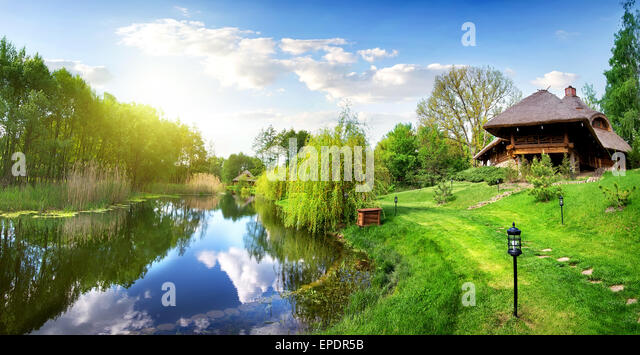 House of log near river in the morning - Stock Image