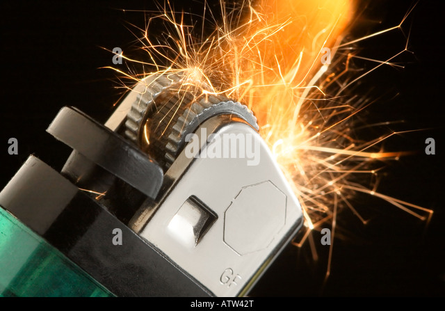 A closeup of a pocket lighter parking and flaming - Stock Image