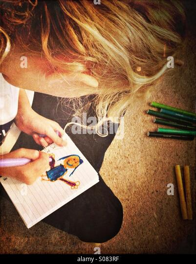Young girl drawing picture of girl - Stock-Bilder