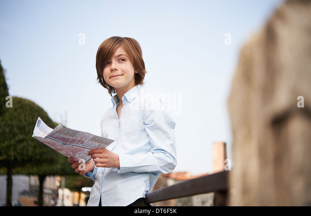 Young boy looking at map in park, Province of Venice, Italy - Stock Image