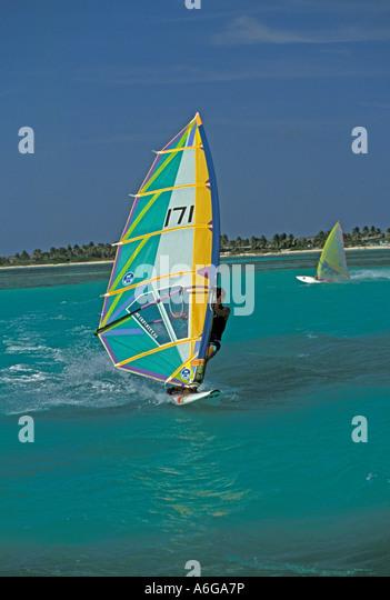 Aruba tourists windsurfing Palm Beach action wake outdoor recreation - Stock Image