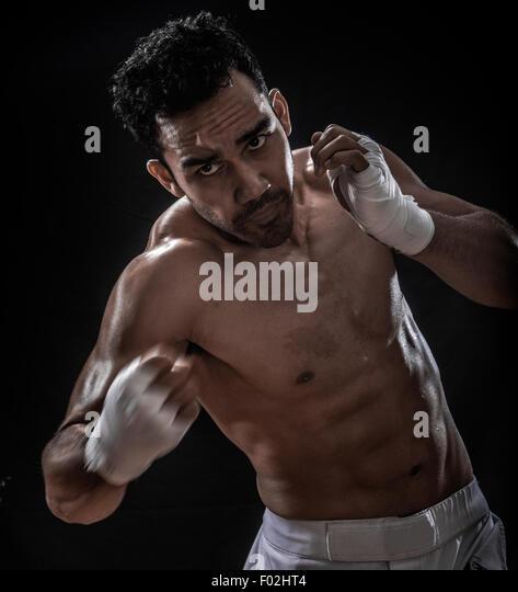 Male boxer punching - Stock Image