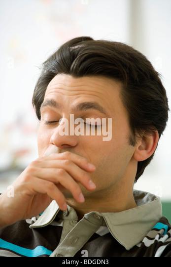 MAN SNEEZING - Stock Image
