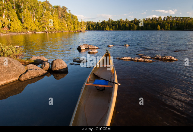 A solo canoe on Lake Alice in the Boundary Waters Canoe Area Wilderness, Minnesota, USA. - Stock Image