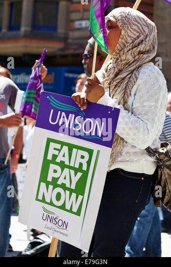 Woman holding unison protest board - Stock Image