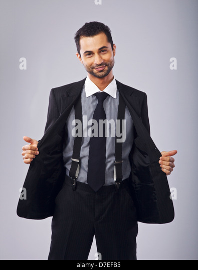 Portrait of a cute and cheerful young professional holding open his coat - Stock Image