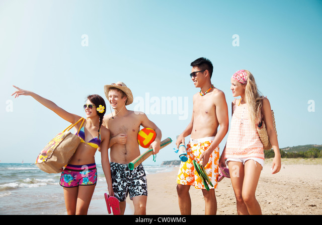 group of young people going to the beach - Stock Image