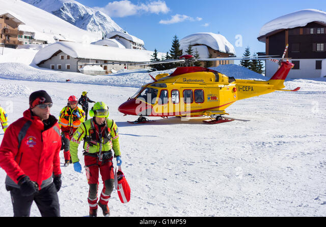 MADESIMO - FEBRUARY 22: Rescue helicopter evacuates skier after accident, Madesimo, Italy on February 22, 2014. - Stock Image