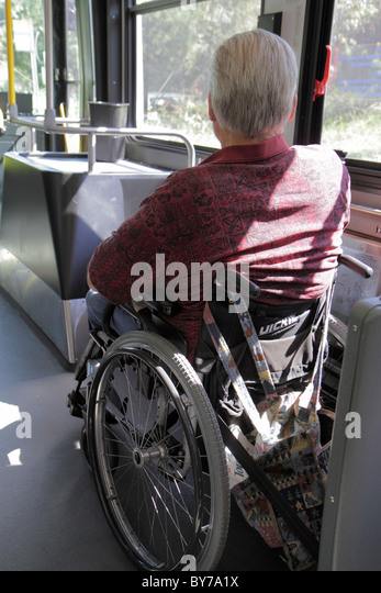 Atlanta Georgia MARTA public transportation bus man passenger wheelchair ADA accessible disabled - Stock Image
