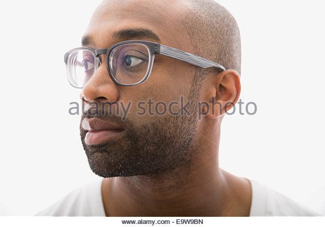 Portrait of pensive man with eyeglasses and beard - Stock-Bilder
