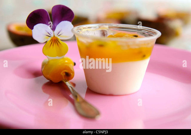 Coconut panna cotta with passion fruit - Stock Image