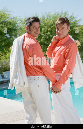 Newlywed gay couple holding hands - Stock-Bilder