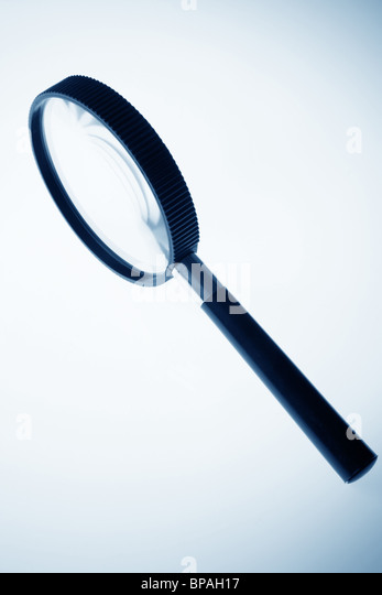 magnifier close up in blue tone - Stock Image