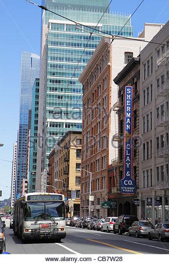 California San Francisco Mission Street downtown street scene trolleybus electric bus mass transit public transportation - Stock Image