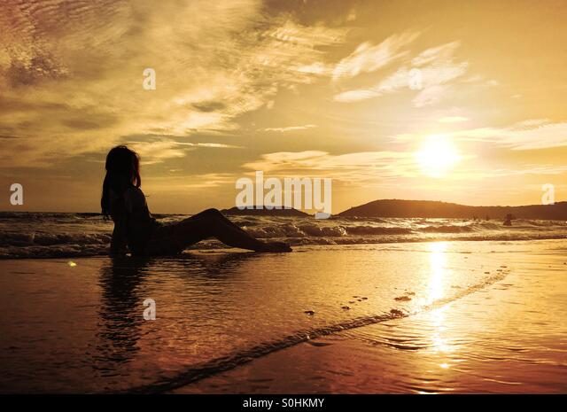 Lonely girl on the beach - Stock Image