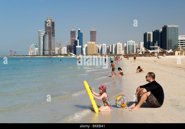 The beachfront and buildings in Abu Dhabi in the United Arab Emirates. - Stock Image
